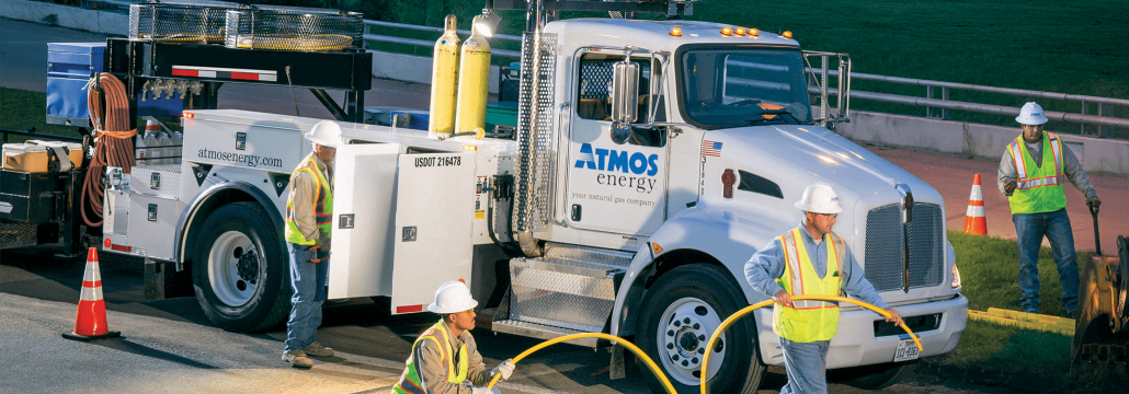 Atmos Energy crew working in the evening in front of downtown Dallas.