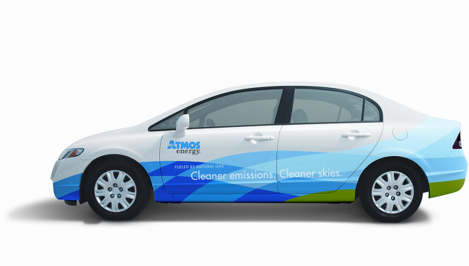 Atmos Energy natural gas vehicle that is blue and green with logo
